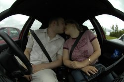 Me and John kissing in the car at Birdowald fort