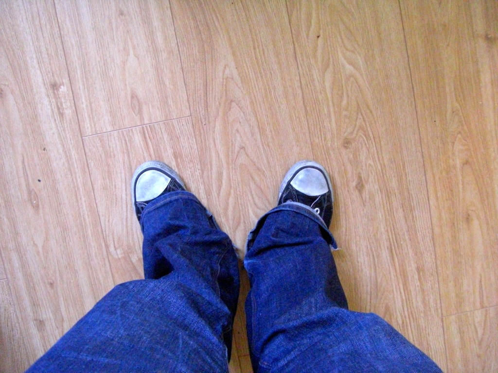 my feet on a wooden floor